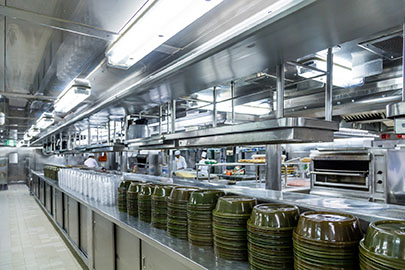 Stacks of Empty Serving Dishes in Commercial Kitchen